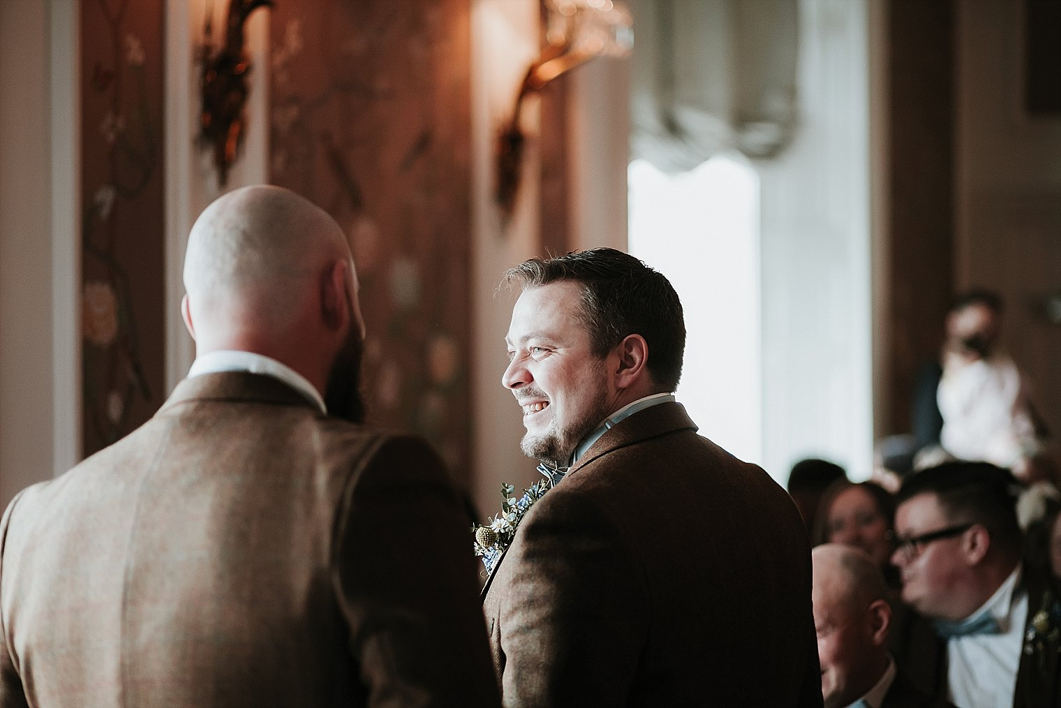 Best man laughing with the groom