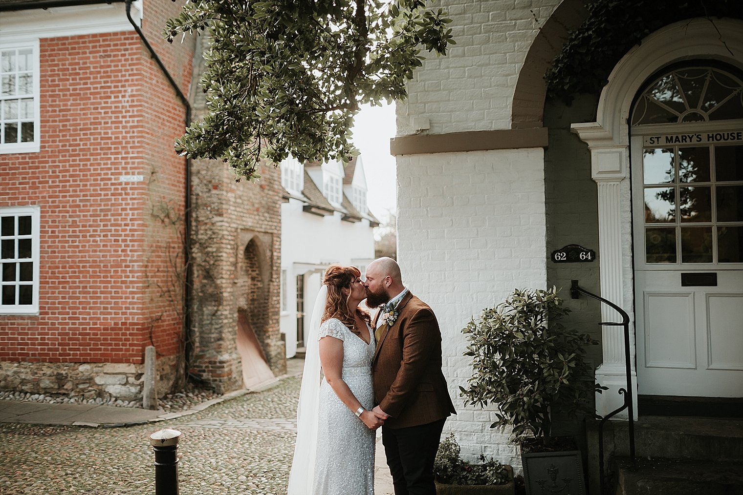 Bride and groom kissing in Rye after their wedding at the george hotel