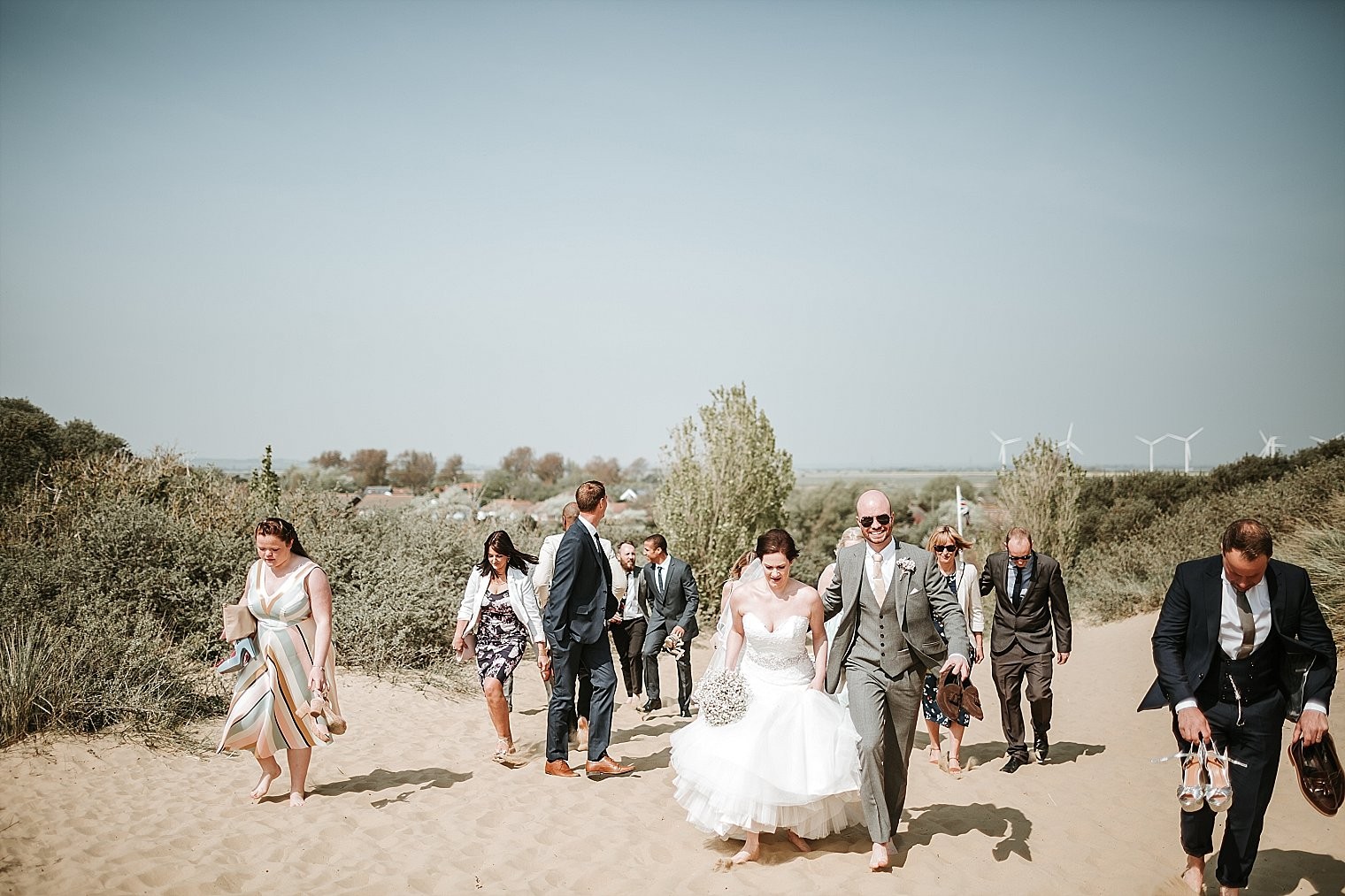 Bride and Groom walking on Camber Sands
