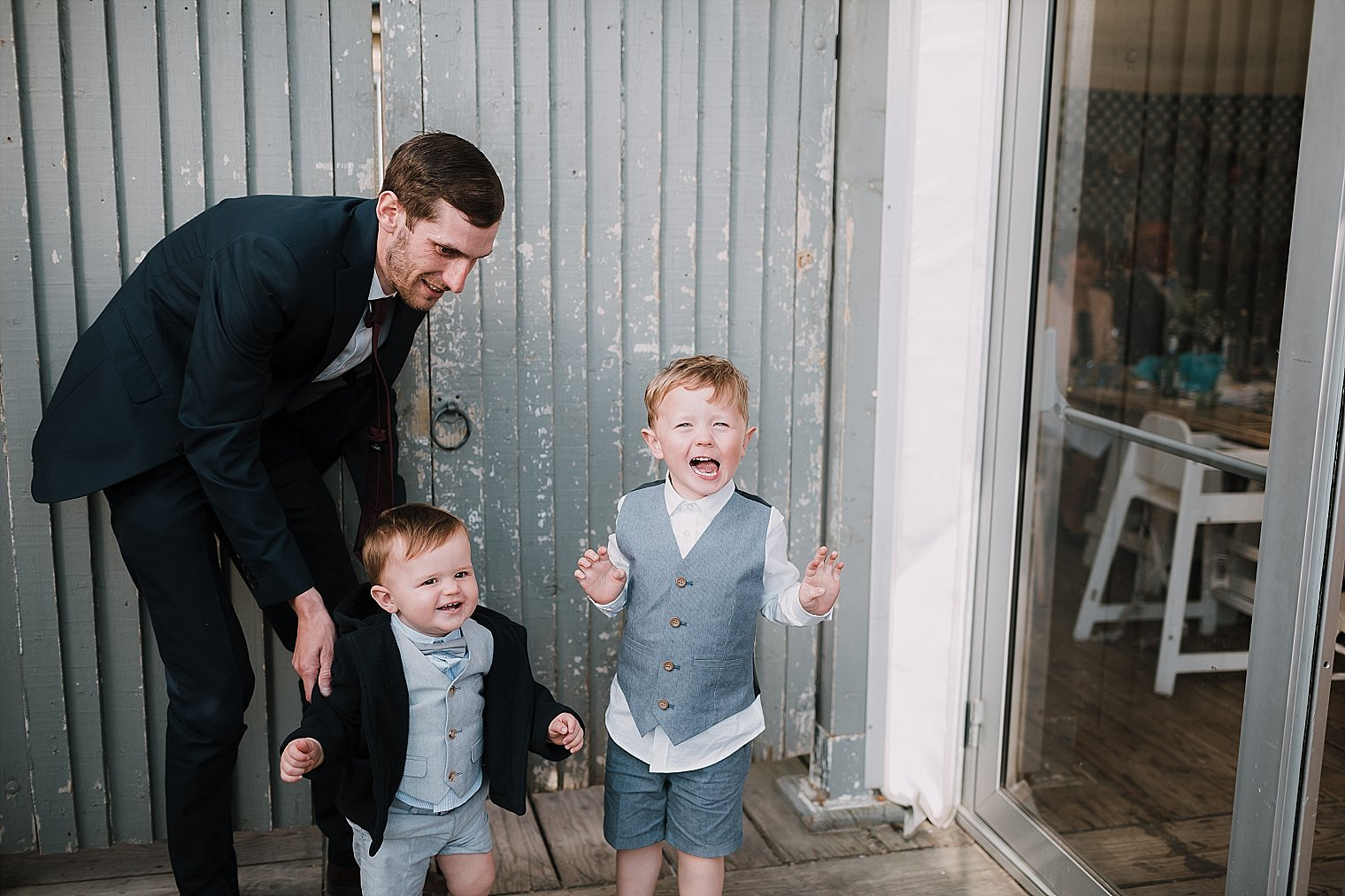 Young wedding guests laughing