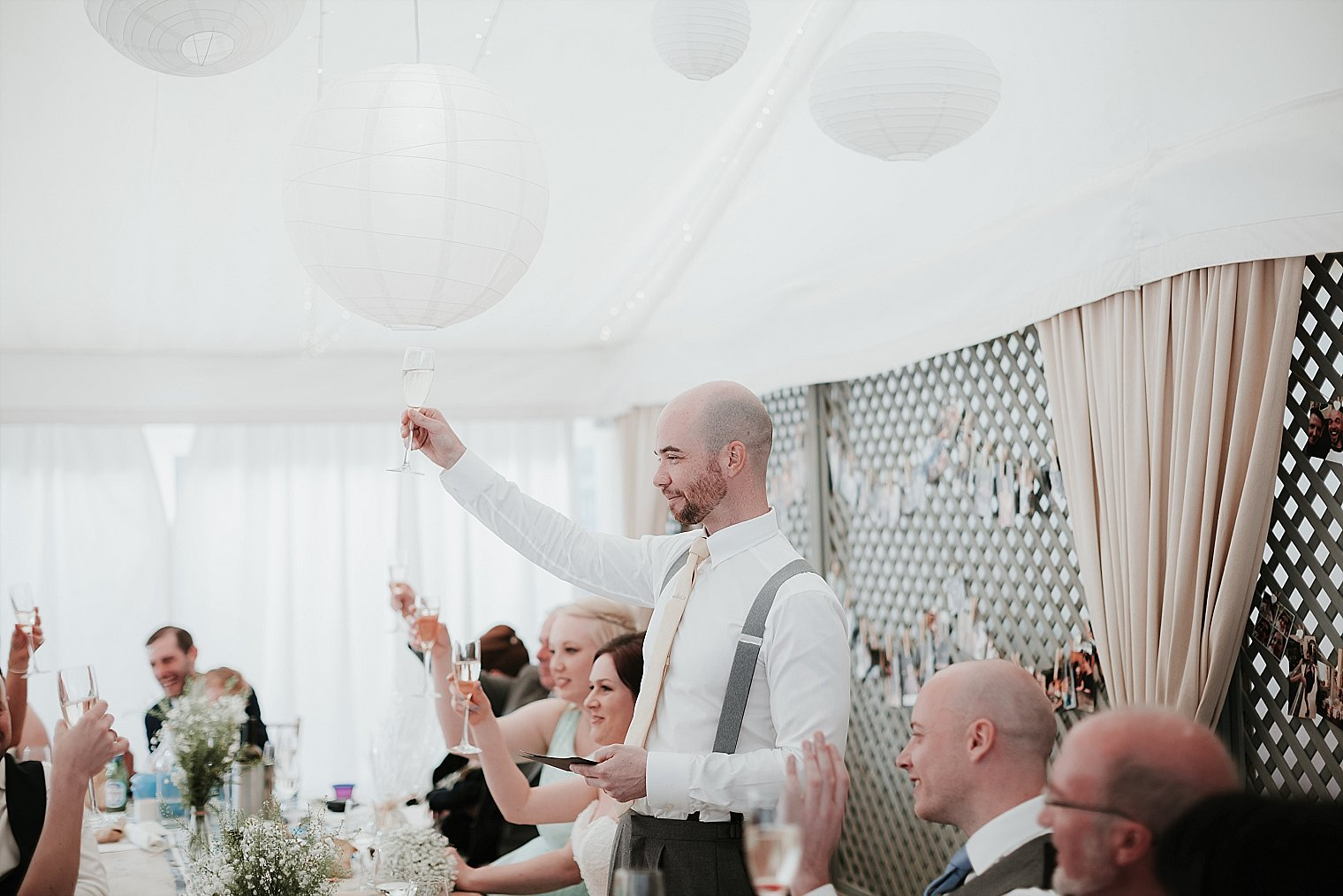 Groom toasting bridesmaids