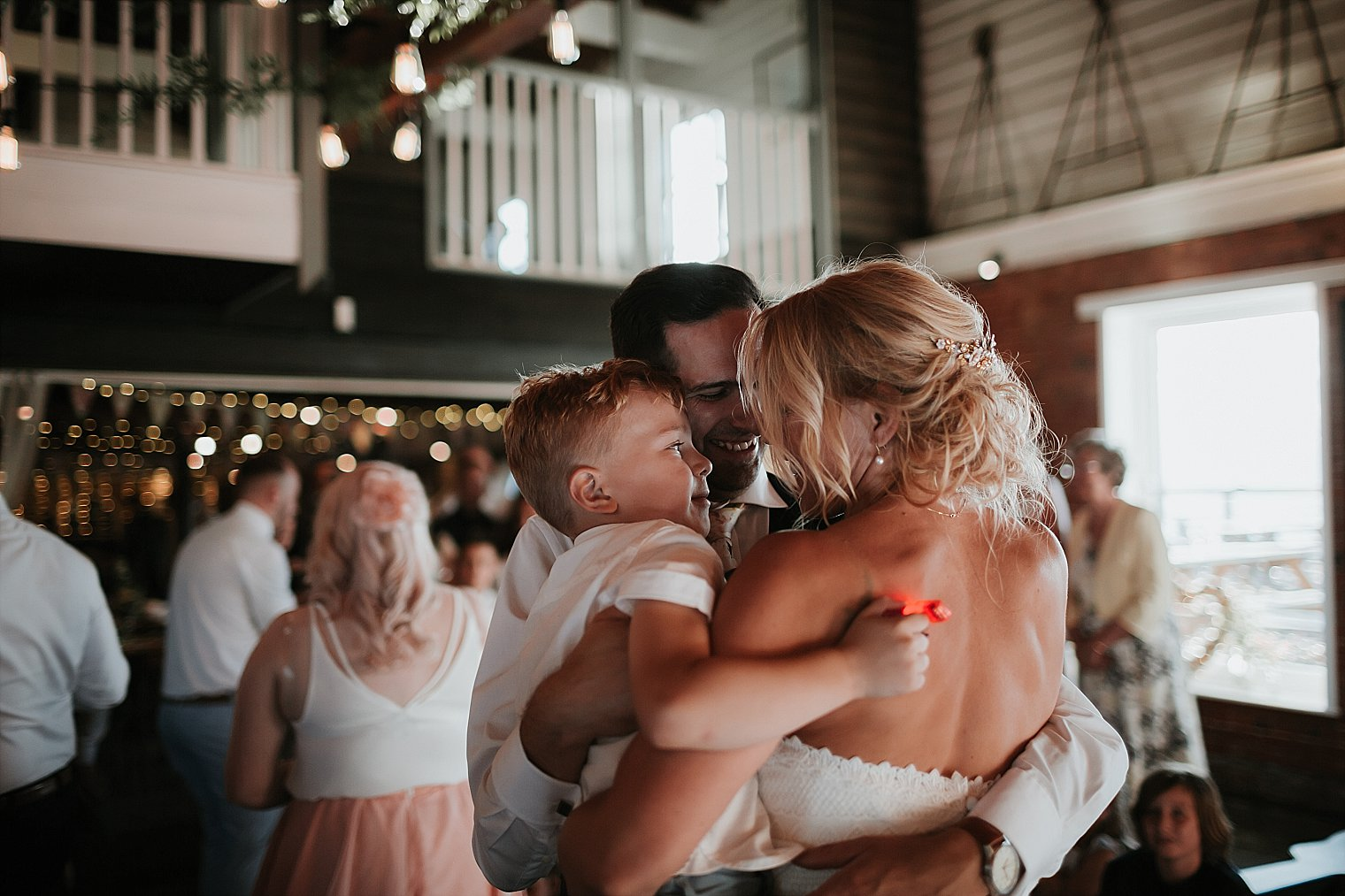 Bride and Groom holding their son during first dance at The Lobster Shack